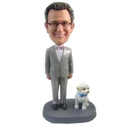 Male and a dog bobblehead doll